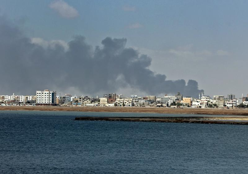 Smoke billows in the Yemeni government's de facto capital Aden as fighters from the separatist Southern Transitional Council take full control of the port city (AFP Photo/SALEH AL-OBEIDI)