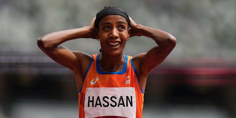 Sifan Hassan with her hands on her head after winning her heat at the Tokyo Olympics.
