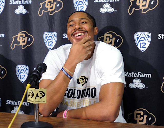 Colorado junior point guard Spencer Dinwiddie announces that he will skip his senior season and declare for the NFL basketball draft, Thursday, April 24, 2014, in Boulder, Colo. (AP Photo/Daily Camera, Cliff Grassmick)