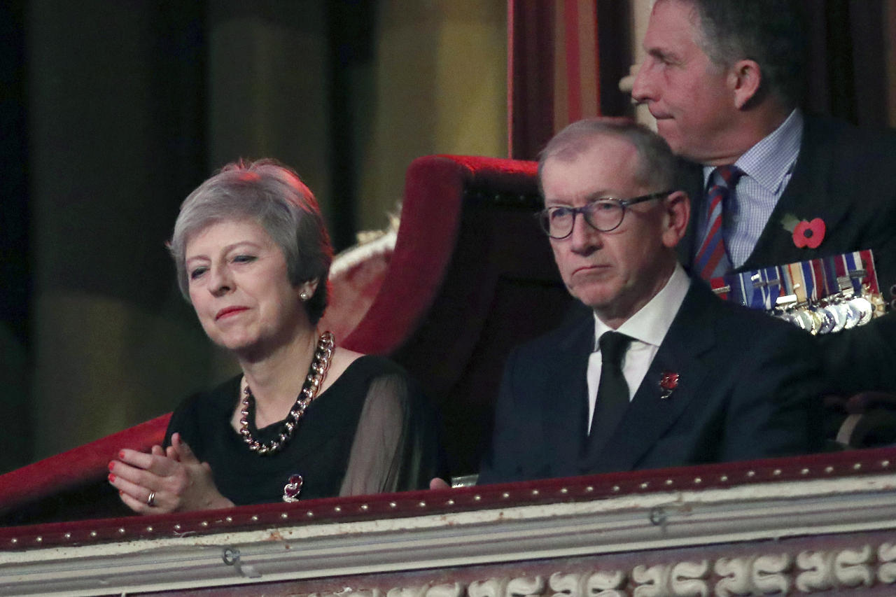 Britain's Prime Minister Theresa May with husband Philip May attend the Royal British Legion Festival of Remembrance at the Royal Albert Hall in London, Saturday, Nov. 10, 2018. The Queen and members of the Royal Family are attending the annual Festival of Remembrance to commemorate all those who have lost their lives in conflicts and will mark 100 years since the end of the First World War. (Chris Jackson/Pool Photo via AP)