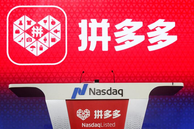 The logo of online group discounter Pinduoduo is seen on a stage before the company's stock trading debut at the Nasdaq Stock Market in New York, during an event in Shanghai