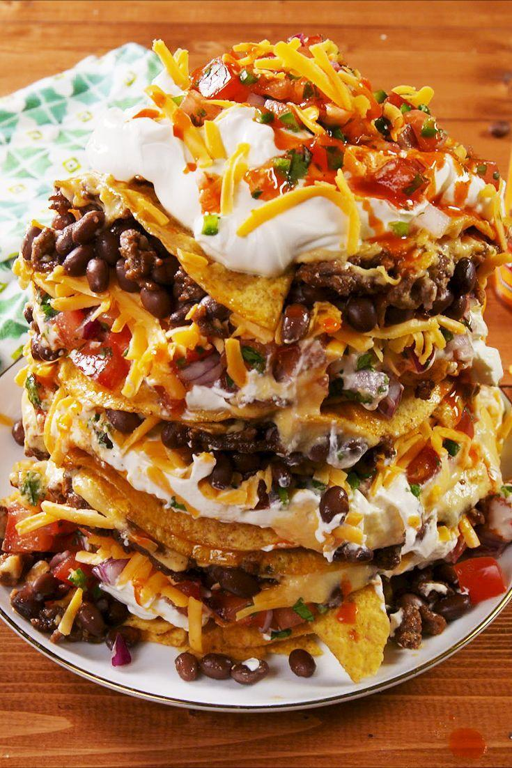 """<p>A plate of nachos is great, but a TOWER of nachos is literally next-level. </p><p>Get the recipe from <a href=""""https://www.delish.com/cooking/recipe-ideas/a25751125/trash-can-nachos-recipe/"""" rel=""""nofollow noopener"""" target=""""_blank"""" data-ylk=""""slk:Delish"""" class=""""link rapid-noclick-resp"""">Delish</a>. </p>"""
