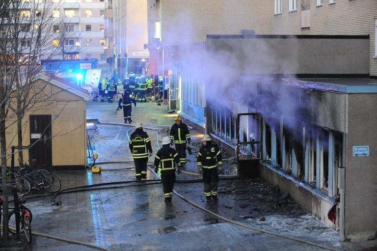 Smoke rises from the interior of a destroyed mosque after an arson attack on December 25, 2014 in Eskilstuna, central Sweden