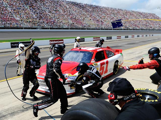 BROOKLYN, MI - JUNE 17: Kurt Busch, driver of the #51 Phoenix Construction Services Chevrolet, pits after an incident early in the NASCAR Sprint Cup Series Quicken Loans 400 at Michigan International Speedway on June 17, 2012 in Brooklyn, Michigan. (Photo by John Harrelson/Getty Images for NASCAR)