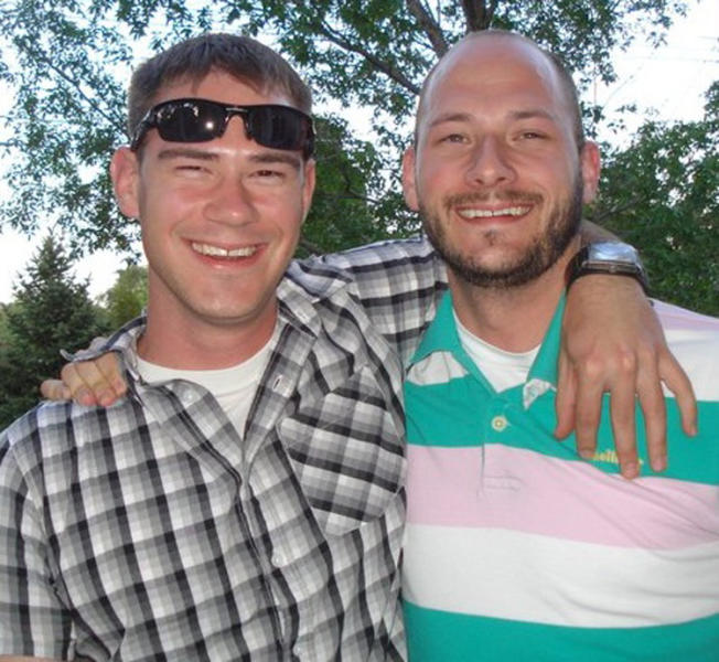 This family photo provided via The Kalamazoo Gazette shows Army Capt. Drew E. Russell, left, with his brother James, in Colorado, just before being deployed to Afghanistan in the summer of 2011. Russell and Army Capt. Joshua Lawrence were inside a small command post on an Afghan army base, when an exploding grenade was followed in seconds by bursts of gunfire. Before any of the Americans could raise a hand to defend themselves, Lawrence was dead, one 5.56mm bullet to the head, and Russell was dying, shot three times in the back. (AP Photo/Russell Family via The Kalamazoo Gazette)