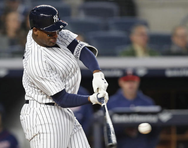 New York Yankees' Miguel Andujar hits a second-inning solo home run during a baseball game against the Minnesota Twins in New York, Monday, April 23, 2018. (AP Photo/Kathy Willens)