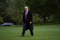 FILE - In this Thursday, Oct. 1, 2020, file photo, President Donald Trump walks from Marine One to the White House in Washington as he returns from Bedminster, N.J. For the past four years, Trump has enjoyed special status not given to regular users on Twitter and Facebook even as he used his perch atop the social media pyramid to peddle misinformation and hurl abuse at his critics. Could his loose leash on the platforms come to an end on Jan. 20, 2021, when his successor is inaugurated? (AP Photo/Carolyn Kaster, File)