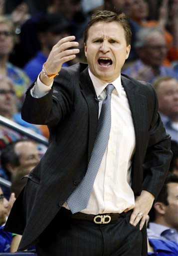Oklahoma City Thunder head coach Scott Brooks shouts to his team during the second quarter of an NBA basketball game against the San Antonio Spurs in Oklahoma City, Friday, March 16, 2012. (AP Photo/Sue Ogrocki)