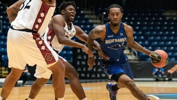 Nighthawks guard Cat Barber, right, scored the game-ending layup in Guelph's 90-74 win over the Saskatchewan Rattlers on Friday. (@Gnighthawks/Twitter - image credit)
