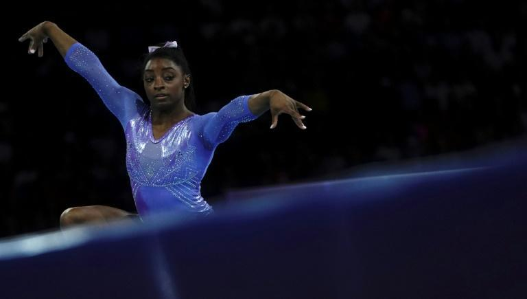 Simone Biles won the floor title for the fifth time in her career at the world gymnastics championships on Sunday in Stuttgart