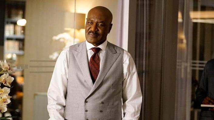Delroy Lindo stands in a waistcoat and tie