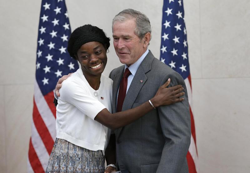 Former President George W. Bush, right, poses for a photo with Mondell Bernadette Avril after she was sworn in as a U.S. citizen during a ceremony at the The George W. Bush Presidential Center in Dallas, Wednesday, July 10, 2013. Twenty new citizens took the oath of U.S. citizenship at the former president's library. (AP Photo/LM Otero)