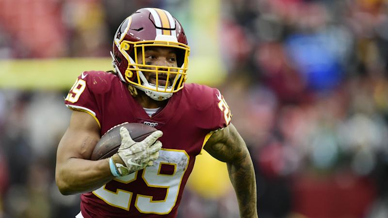 Guice released by Washington after domestic violence arrest