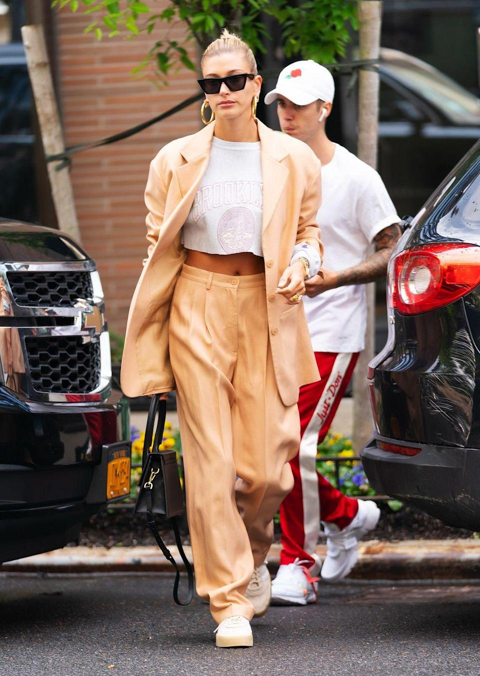 <p>Repurpose your internship suit with sneakers, jumbo hoops, and a cropped graphic tee for an effortlessly stylish look perfect for the first day of school. </p>