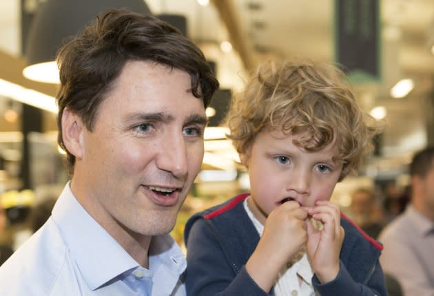 Prime Minister Justin Trudeau with his son Hadrien in Drummondville, Que., on June 23, 2018.