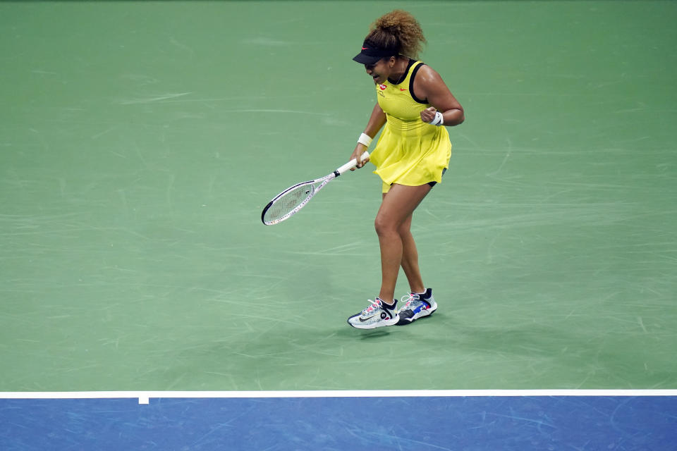 Naomi Osaka, of Japan, reacts after winning a point against Marie Bouzkova, of the Czech Republic, during the first round of the US Open tennis championships, Monday, Aug. 30, 2021, in New York. (AP Photo/Frank Franklin II)