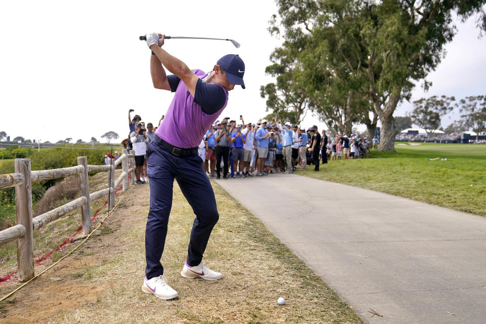 Rory McIlroy, of Northern Ireland, hits from alongside the cart path on the 15th fairway during the third round of the U.S. Open Golf Championship, Saturday, June 19, 2021, at Torrey Pines Golf Course in San Diego. (AP Photo/Jae C. Hong)