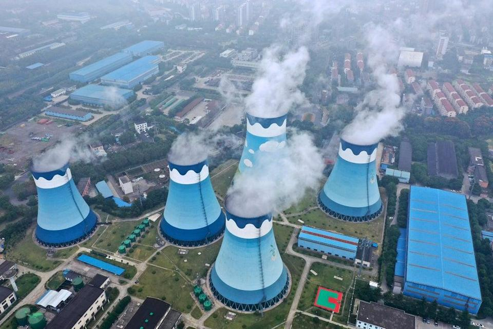 Steam billows out of the cooling towers at a coal-fired power station in Nanjing in east China's Jiangsu province. Global shoppers face possible shortages of smartphones and other goods ahead of Christmas (AP)