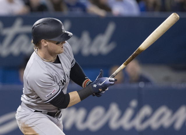 New York Yankees' Clint Frazier hits a single against the Toronto Blue Jays during the sixth inning of a baseball game Wednesday, June 5, 2019, in Toronto. (Fred Thornhill/The Canadian Press via AP)