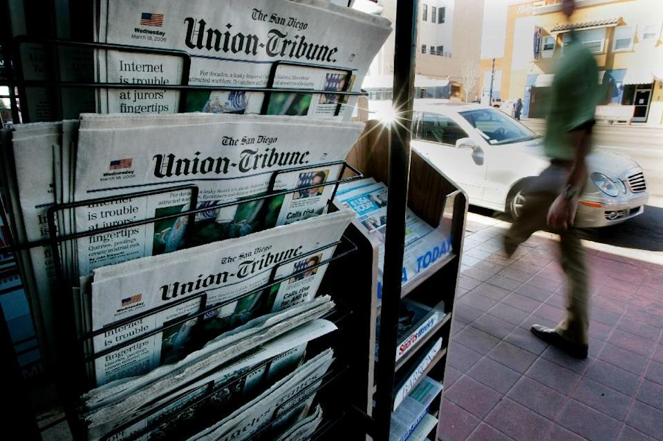 "The sale of the San Diego Union-Tribune in early May for $85 million underscored the horrific slump in the value of ""old media"" companies in recent years (AFP Photo/Sandy Huffaker)"