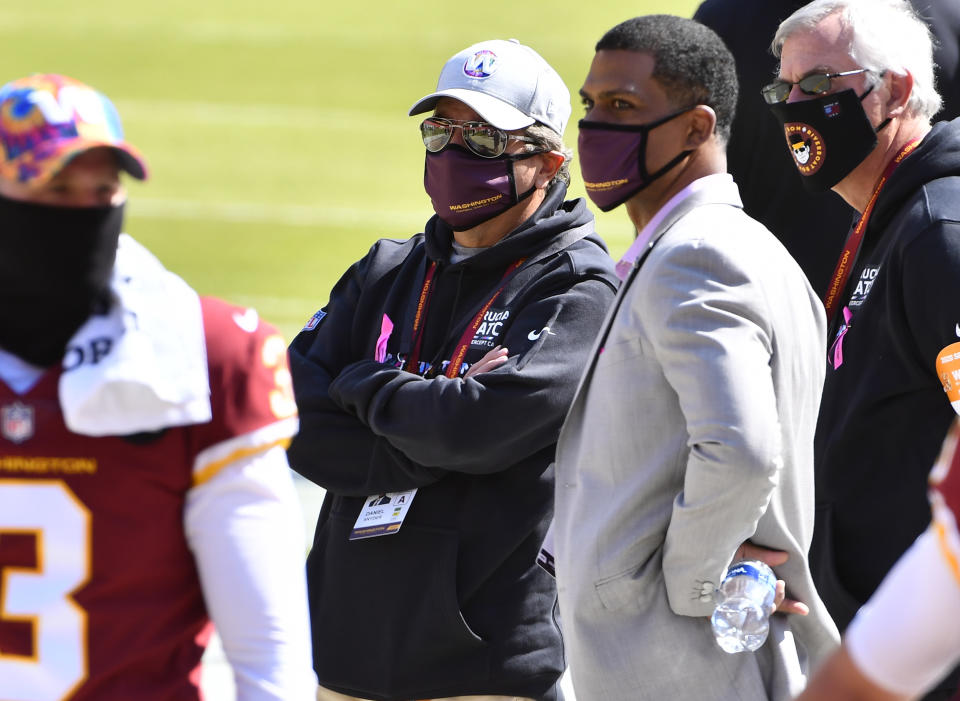 Oct 4, 2020; Landover, Maryland, USA; Washington Football Team owner Daniel Snyder and Washington Football Team President Jason Wright on the field before the game against the Baltimore Ravens at FedExField. Mandatory Credit: Brad Mills-USA TODAY Sports