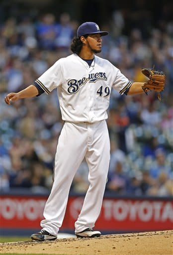 Milwaukee Brewers' pitcher Yovani Gallardo watches as Chicago Cubs' Bryan LaHair hits a home run in the fourth inning of a baseball game, Tuesday, June 5, 2012, in Milwaukee. (AP Photo/Tom Lynn)