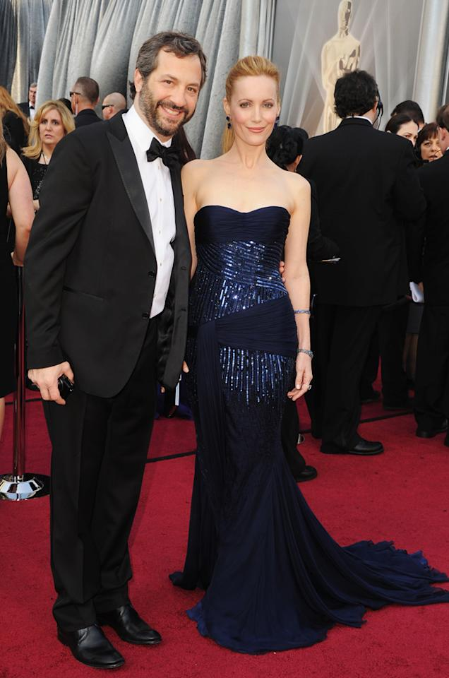 Judd Apatow and Leslie Mann arrive at the 84th Annual Academy Awards in Hollywood, CA.
