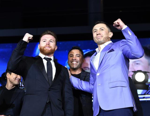 Gennady Golovkin (R) won't commit to a rematch with Canelo Alvarez (L) just yet. (Getty Images)