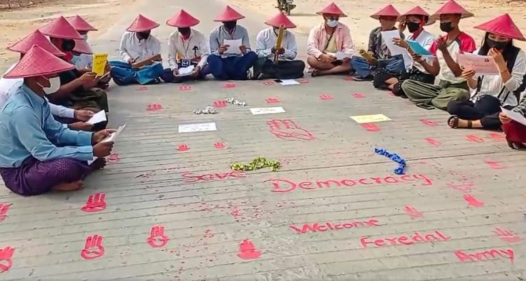Demonstrators take part in a poetry reading as part of protests against Myanmar's military coup