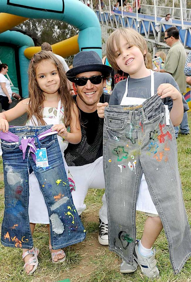 """Meanwhile, Mark-Paul Gosselaar and his kids Ava, 4, and Michael, 6, played around with some paint and denim to make jeans that nobody else in school will have -- guaranteed! Michael Buckner/<a href=""""http://www.gettyimages.com/"""" target=""""new"""">GettyImages.com</a> - June 13, 2010"""