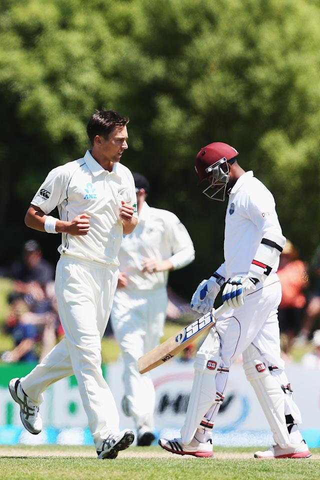 DUNEDIN, NEW ZEALAND - DECEMBER 05: Trent Boult of New Zealand celebrates the wicket of Denesh Ramdin of the West Indies during day three of the first test match between New Zealand and the West Indies at University Oval on December 5, 2013 in Dunedin, New Zealand. (Photo by Hannah Johnston/Getty Images)