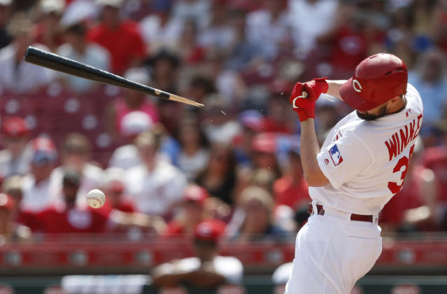 Cincinnati Reds' Jesse Winker breaks a bat as he grounds out to Chicago Cubs relief pitcher Rowan Wick during the eighth inning of a baseball game, Sunday, Aug. 11, 2019, in Cincinnati. (AP Photo/Gary Landers)