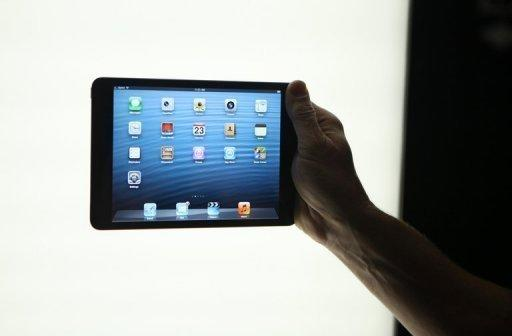 Apple's newly introduced iPad mini is seen during a special event at the California Theatre in San Jose in October 2012. Apple's new iPad mini debuted on Friday with less fanfare than previous incarnations amid talk it might have come too late to the 7-inch tablet computer market