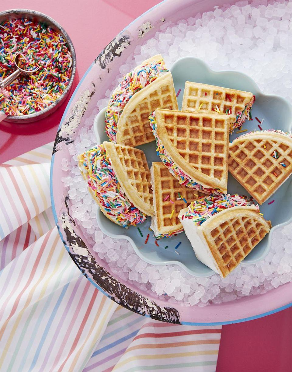 """<p>Bring on the summer fun with these ice cream sandwiches that use waffles instead of cookies. </p><p><strong><em><a href=""""https://www.womansday.com/food-recipes/a32883702/rainbow-waffle-wiches-recipe/"""" rel=""""nofollow noopener"""" target=""""_blank"""" data-ylk=""""slk:Get the Rainbow Waffle-wiches recipe."""" class=""""link rapid-noclick-resp"""">Get the Rainbow Waffle-wiches recipe. </a></em></strong></p>"""