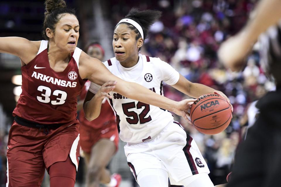 South Carolina guard Tyasha Harris (52) dribbles against Arkansas guard Chelsea Dungee (33) during the second half of an NCAA college basketball game Thursday, Jan. 9, 2020, in Columbia, S.C. (AP Photo/Sean Rayford)