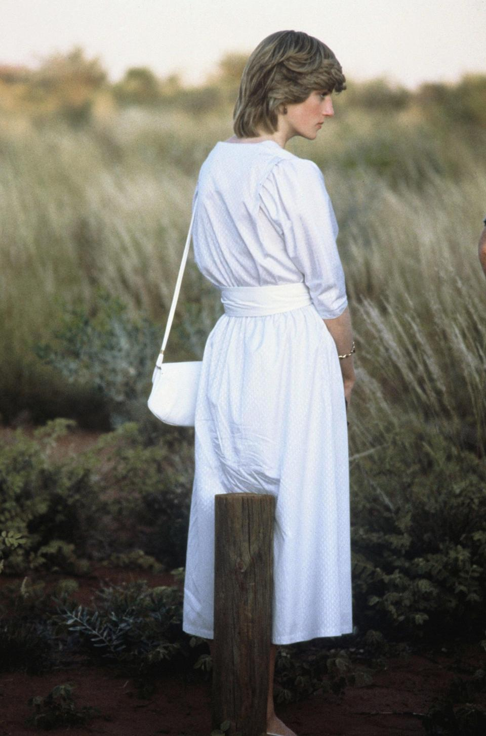 <p>Diana's most similar shape that we could find is seen here, worn with a casual white shirtdress for a visit to Ayers Rock during a tour of Australia in 1983.</p>