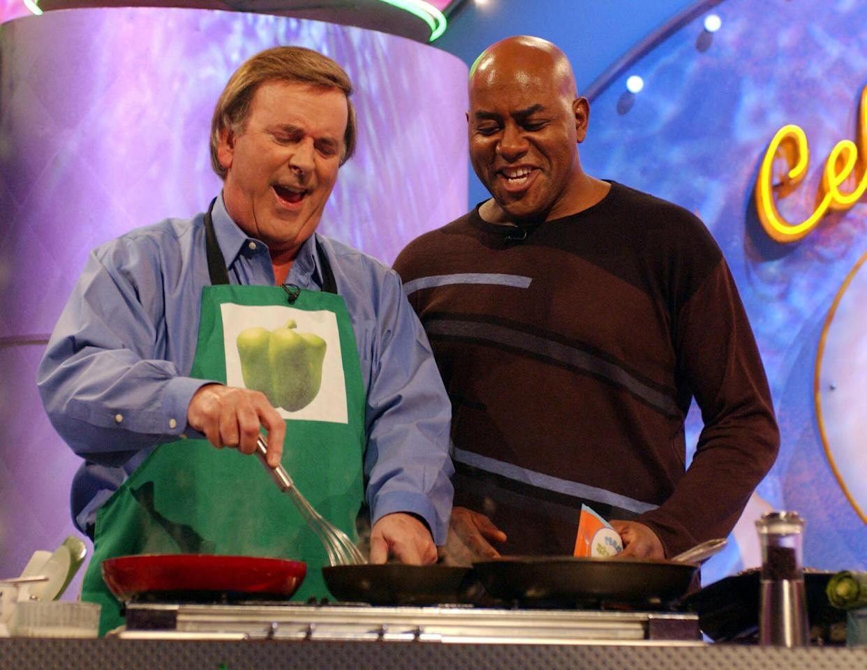 TV chef Ainsley Harriott (right) talks to guest Terry Wogan during a special edition of 'Ready Steady Cook' in aid of 'Children In Need' at Capital Studios, south west London.