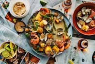 """Clams, potatoes, shrimp, and corn on the cob get an extra layer of flavor when grilled and brushed with gingery miso butter. This 4th of July recipe is a whole meal in one; add some bread and follow it up with <a href=""""https://www.epicurious.com/recipes-menus/19-ice-creams-of-your-dreams-gallery?mbid=synd_yahoo_rss"""" rel=""""nofollow noopener"""" target=""""_blank"""" data-ylk=""""slk:ice cream"""" class=""""link rapid-noclick-resp"""">ice cream</a>, or maybe <a href=""""https://www.epicurious.com/recipes/food/views/bas-best-strawberry-shortcake?mbid=synd_yahoo_rss"""" rel=""""nofollow noopener"""" target=""""_blank"""" data-ylk=""""slk:strawberry shortcake"""" class=""""link rapid-noclick-resp"""">strawberry shortcake</a>. <a href=""""https://www.epicurious.com/recipes/food/views/grilled-clambake-with-miso-lime-butter?mbid=synd_yahoo_rss"""" rel=""""nofollow noopener"""" target=""""_blank"""" data-ylk=""""slk:See recipe."""" class=""""link rapid-noclick-resp"""">See recipe.</a>"""