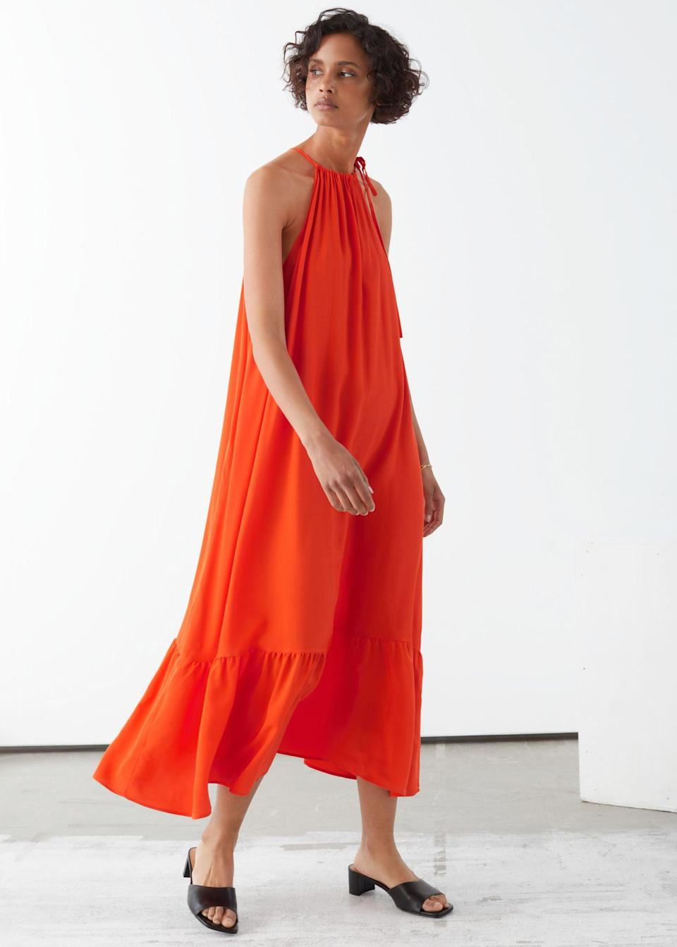 """<br> <br> <strong>& Other Stories</strong> Halterneck A-Line Midi Dress, $, available at <a href=""""https://go.skimresources.com/?id=30283X879131&url=https%3A%2F%2Fwww.stories.com%2Fen_usd%2Fclothing%2Fdresses%2Fmidi-dresses%2Fproduct.halterneck-a-line-midi-dress-orange.0880755001.html"""" rel=""""nofollow noopener"""" target=""""_blank"""" data-ylk=""""slk:& Other Stories"""" class=""""link rapid-noclick-resp"""">& Other Stories</a>"""