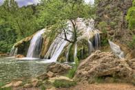 <p>There's a reason Turner Falls Park is a favorite swimming hole for locals: It's home to an impressive 77-foot tall waterfall that you can swim underneath. After taking a dip, explore the rock castle that was built into the hillside nearby.</p>