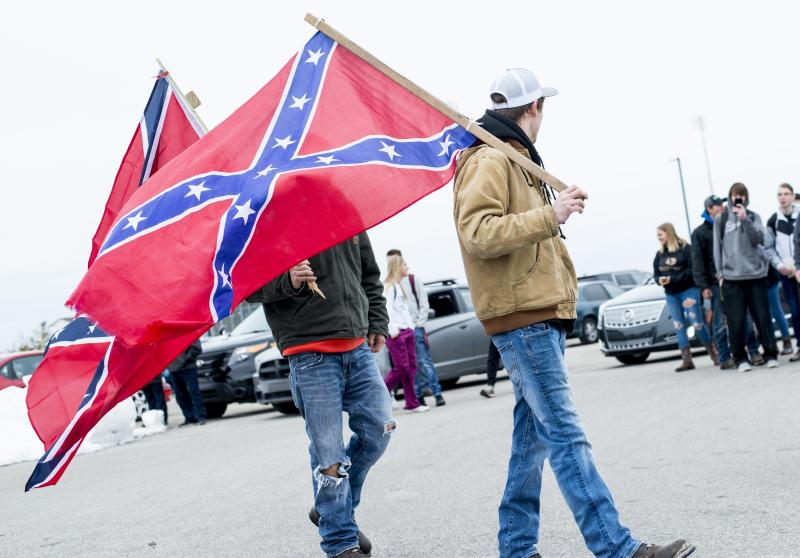 Students demonstrate in support of a Bay City Western High School student, who claims his Confederate flag was torn from his truck last week, Wednesday, April 18 2018, in Auburn, Mich. (Jacob Hamilton/The Bay City Times via AP)