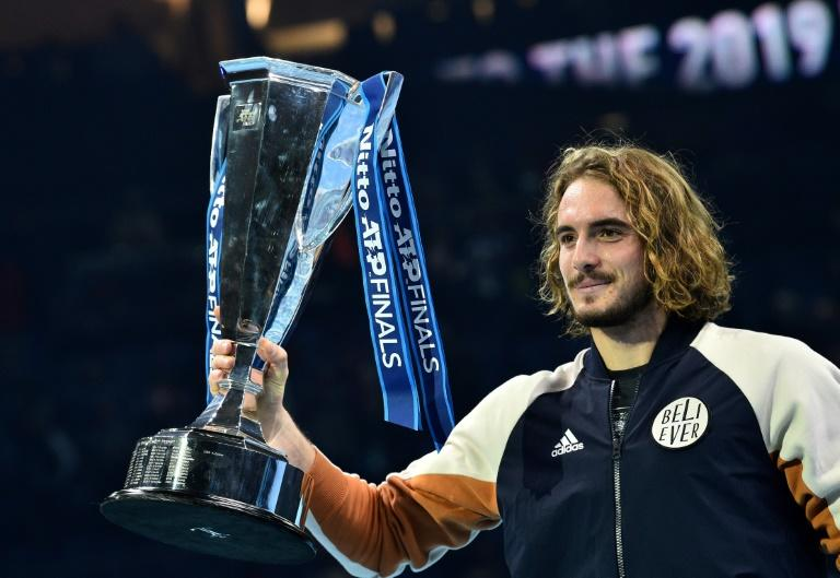 Stefanos Tsitsipas poses with the ATP Finals trophy