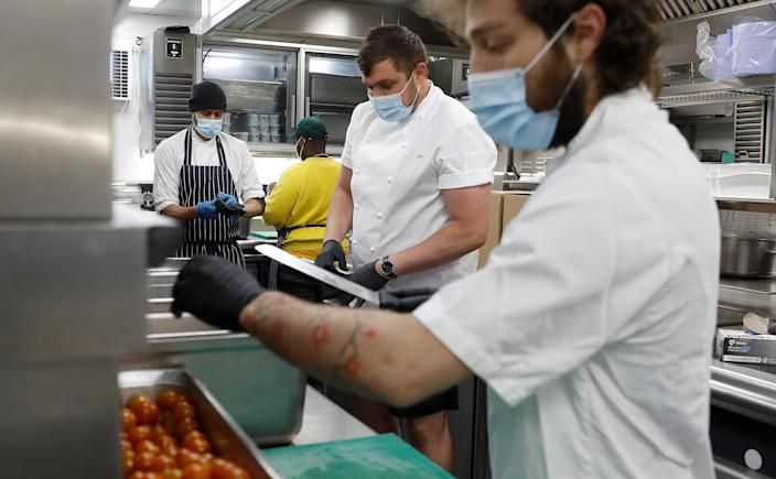 Head Chef at Annabel's private members club, Philip Kearsey, prepares meals for NHS staff with his colleagues at their premises in London, Britain, May 11, 2020. Picture taken May 11, 2020. REUTERS/Peter Nicholls