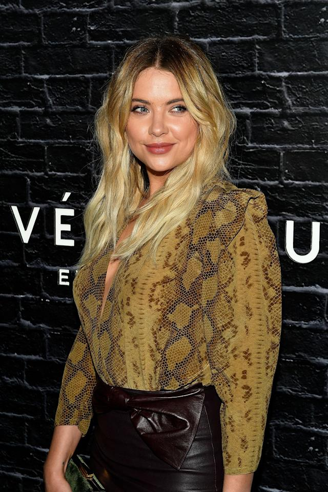 <p>The <em>Pretty Little Liars</em> actress's beachy blond waves, dewy skin and nude lip color is a knockout combo for a night on the town. (Photo: Getty Images) </p>