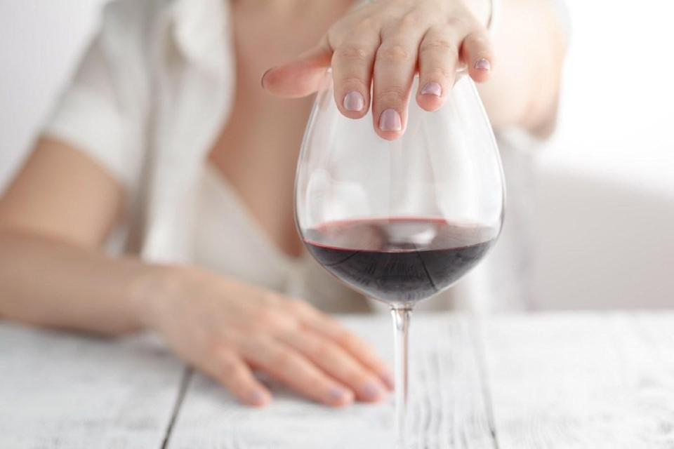 """In addition to adding extra calories to your diet, excessive alcohol consumption can increase your colon cancer risk, according to <strong>Anton Bilchik</strong>, MD, PhD, a <a href=""""https://www.providence.org/doctors/profile/200233-anton-joel-bilchik"""" rel=""""nofollow noopener"""" target=""""_blank"""" data-ylk=""""slk:surgical oncologist and chief of medicine"""" class=""""link rapid-noclick-resp"""">surgical oncologist and chief of medicine</a> at John Wayne Cancer Institute at Providence Saint John's Health Center. If you're going to drink, Bilchik recommends capping it at two glasses a day at the absolute most."""