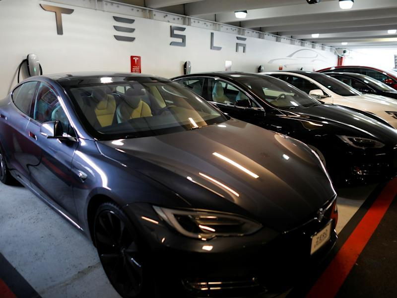 Tesla Model 3s and X's are shown charging in an underground parking lot next to a Tesla store in San Diego, California: REUTERS/Mike Blake