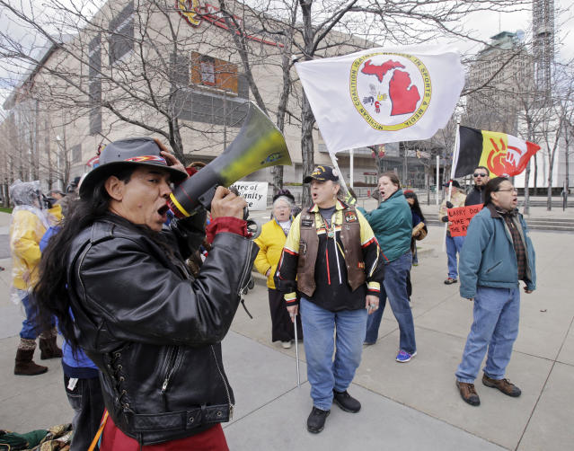 Philip Yenyo, executive director of the American Indian Movement for Ohio, leads a protest of the Cleveland Indians Chief Wahoo mascot before a baseball game against the Detroit Tigers Friday, April 10, 2015, in Cleveland. (AP Photo/Mark Duncan)