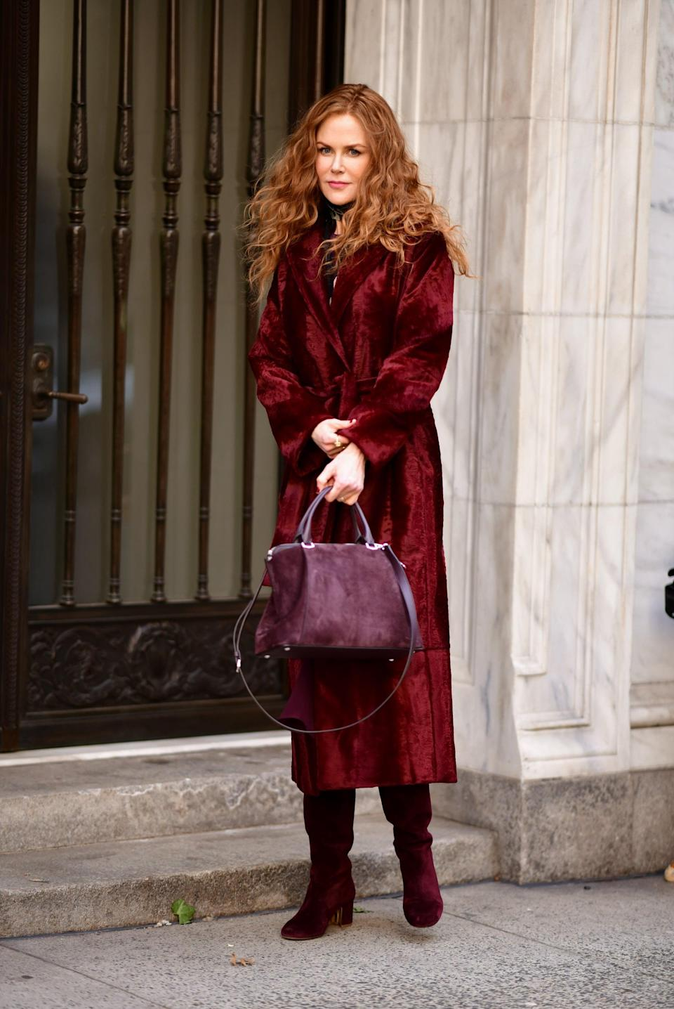 <p>The first coat Grace debuts on <strong>The Undoing</strong> is this red furry-looking number by Max Mara. Signe was drawn to the plush material and wound up purchasing a handful of the coats so she could sew extra fabric on the bottom to make it longer and wider.</p>