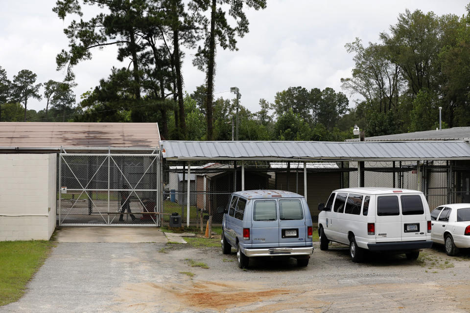 A Hampton County official walks to the county jail before the bond hearing for Alex Murdaugh Thursday, Sept. 16, 2021, in Varnville, S.C. Lawyer Alex Murdaugh surrendered Thursday to face insurance fraud and other charges after state police said he arranged to have himself shot in the head so that his son would get a $10 million life insurance payout. (AP Photo/Mic Smith)