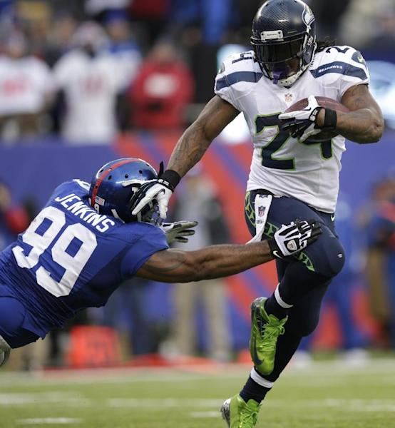 Seattle Seahawks running back Marshawn Lynch (24) avoids the tackle attempt of New York Giants defensive tackle Cullen Jenkins (99) during the second half of an NFL football game, Sunday, Dec. 15, 2013, in East Rutherford, N.J. (AP Photo/Kathy Willens)